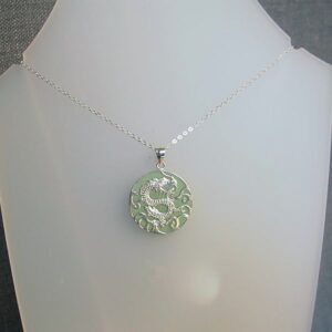 Green jade pendant with sterling silver dragon